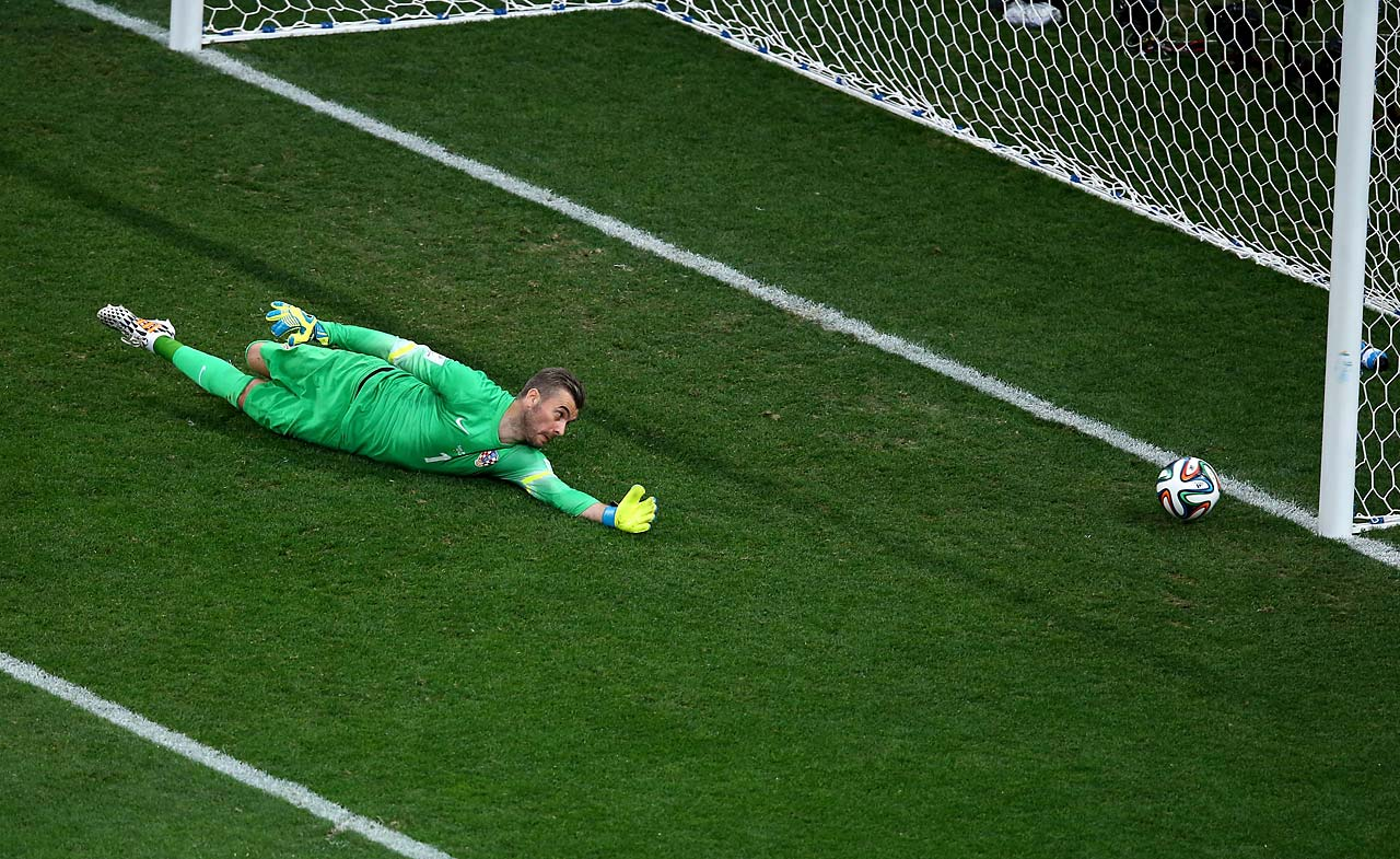 Stipe Pletikosa of Croatia dives and fails to make a save on a shot by Neymar.