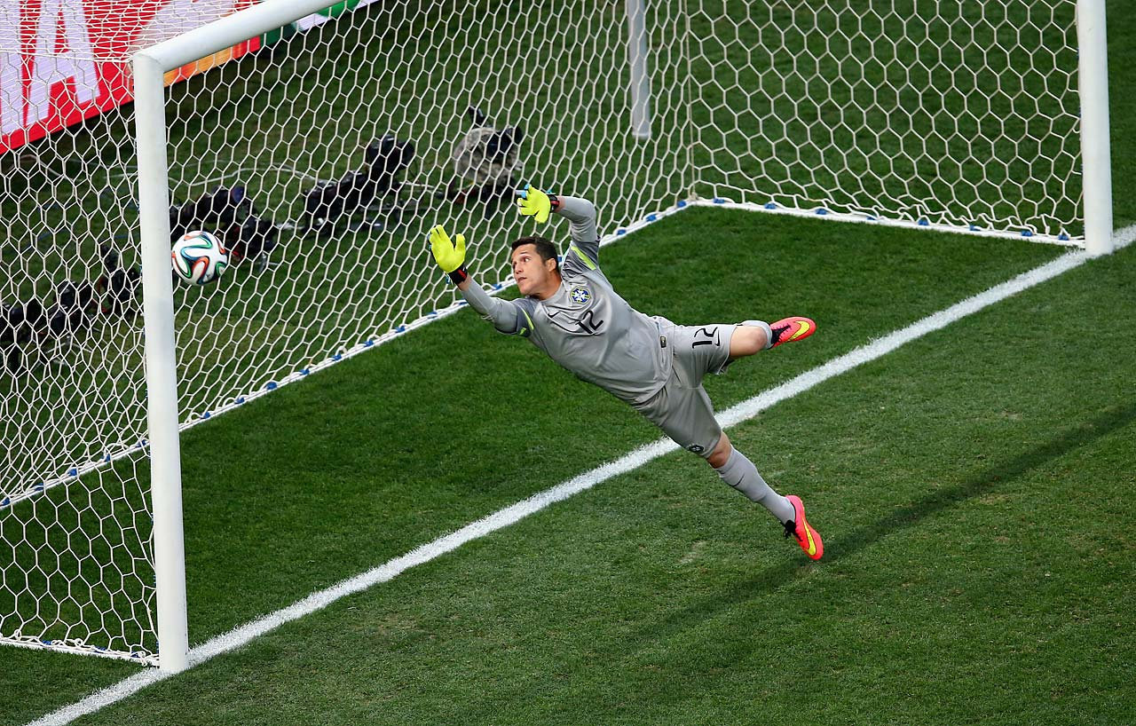 Julio Cesar of Brazil tries to make a save in the first half.