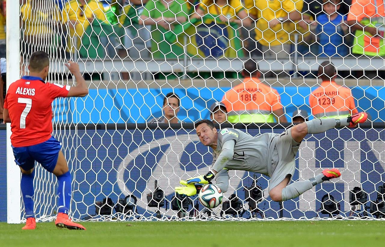 Brazil goalkeeper Julio Cesar makes a save on Chile's Alexis Sanchez during the teams' penalty shootout in the round of 16.