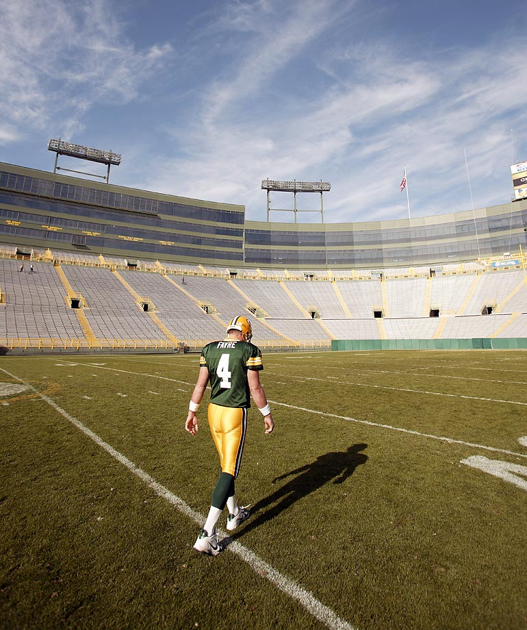 Green Bay Packers quarterback Brett Favre walks off the field at Lambeau in October 2006.