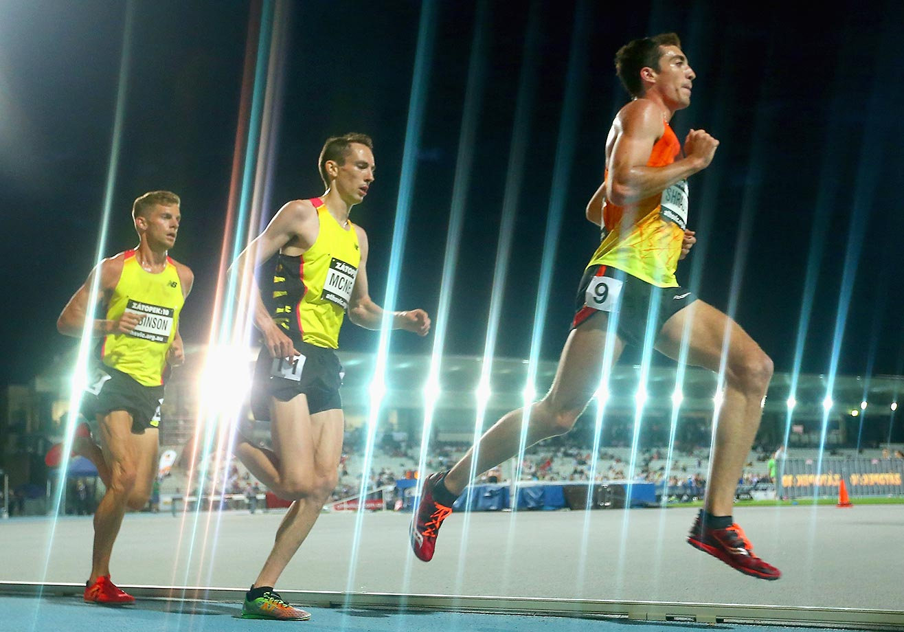 Brett Robinson, David McNeill and Brian Shrader run in the 10,0000-meter race at the Zatopek Open in Australia.