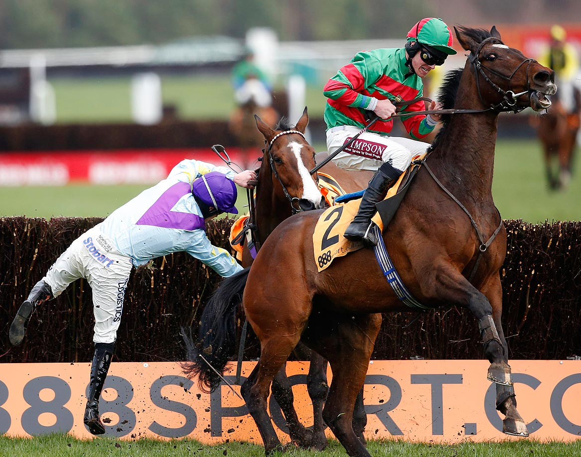 Brian Hughes loses his seat on Sergeant Pink at Haydock racecourse in England.