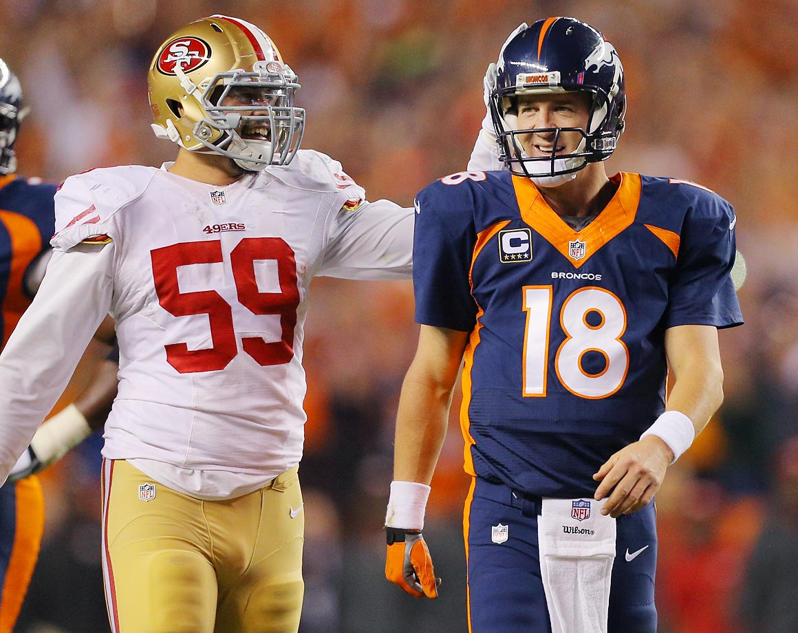 49ers linebacker Aaron Lynch congratulates Peyton Manning after his NFL record 509th career touchdown pass. The Broncos beat the 49ers 42-17.