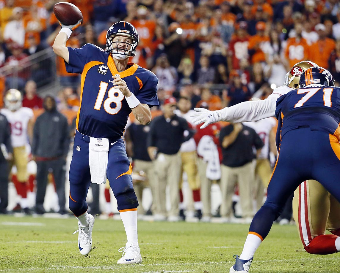 Denver Broncos quarterback Peyton Manning throws for his 509th career touchdown pass, setting an all-time NFL record.