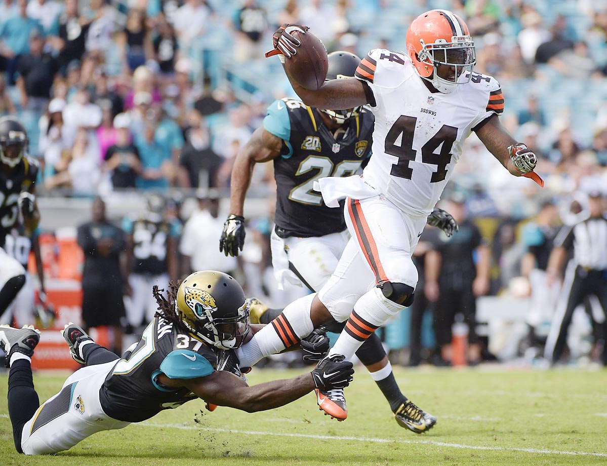 Browns running back Ben Tate is tripped up by Jaguars safety Johnathan Cyprien.