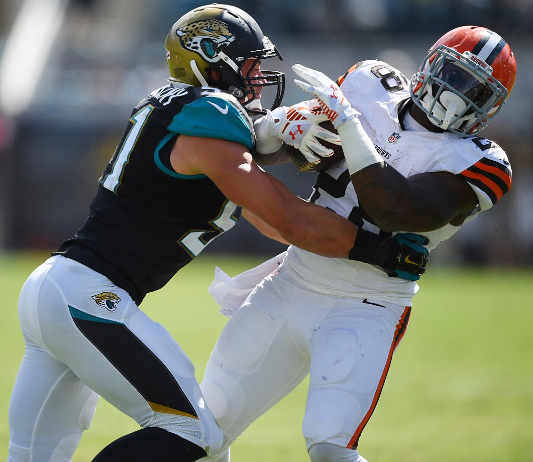 Paul Posluszny of the Jacksonville Jaguars tackles Terrance West of the Cleveland Browns. The Jaguars upset the Browns to win 24-6.