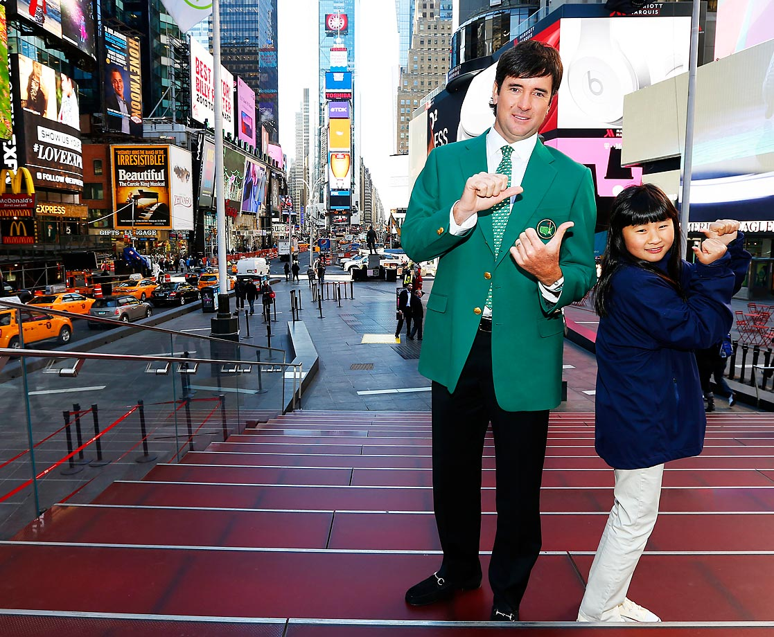 Bubba Watson and defending Drive, Chip & Putt national champion, 10-year old Kelly Xu,pose in Times Square. Watson and Xu were promoting registration for the Drive, Chip & Putt championship.