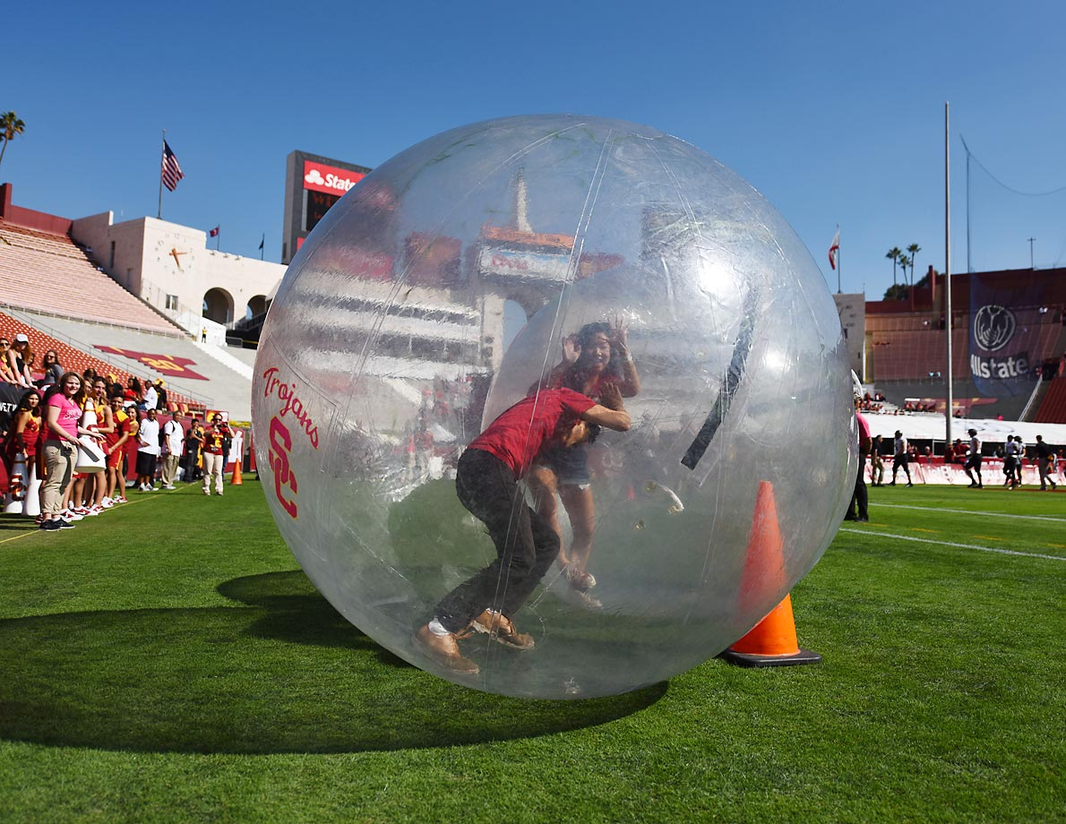 USC students in a bubble before a game against Colorado.