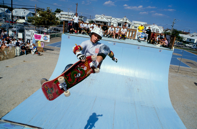 Bucky Lasek, skating for Powell Peralta, does a frontside air above the half pipe during a competition at the Ocean Bowl Skatepark in July 1988 in Ocean City, Maryland.