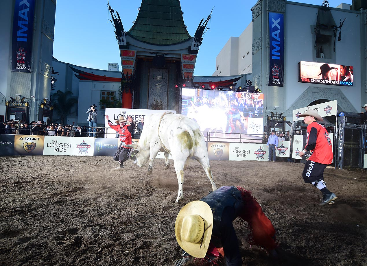 "One down, two to go… Bull riders perform at the premiere of Twentieth Century Fox's ""The Longest RIde"" at the TCL Chinese Theatre IMAX in Hollywood."