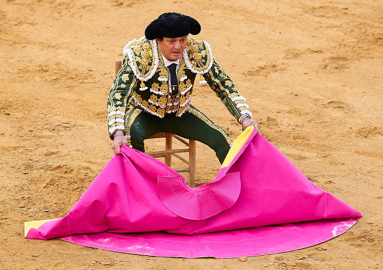 Brining a chair out seems a little too relaxed -- Spanish bullfighter Vicente Ruiz 'El Soro' performs in Valencia, Spain.