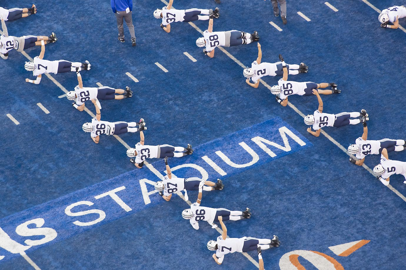 BYU players warm up before their game against Boise State.  Boise State won 55-30.