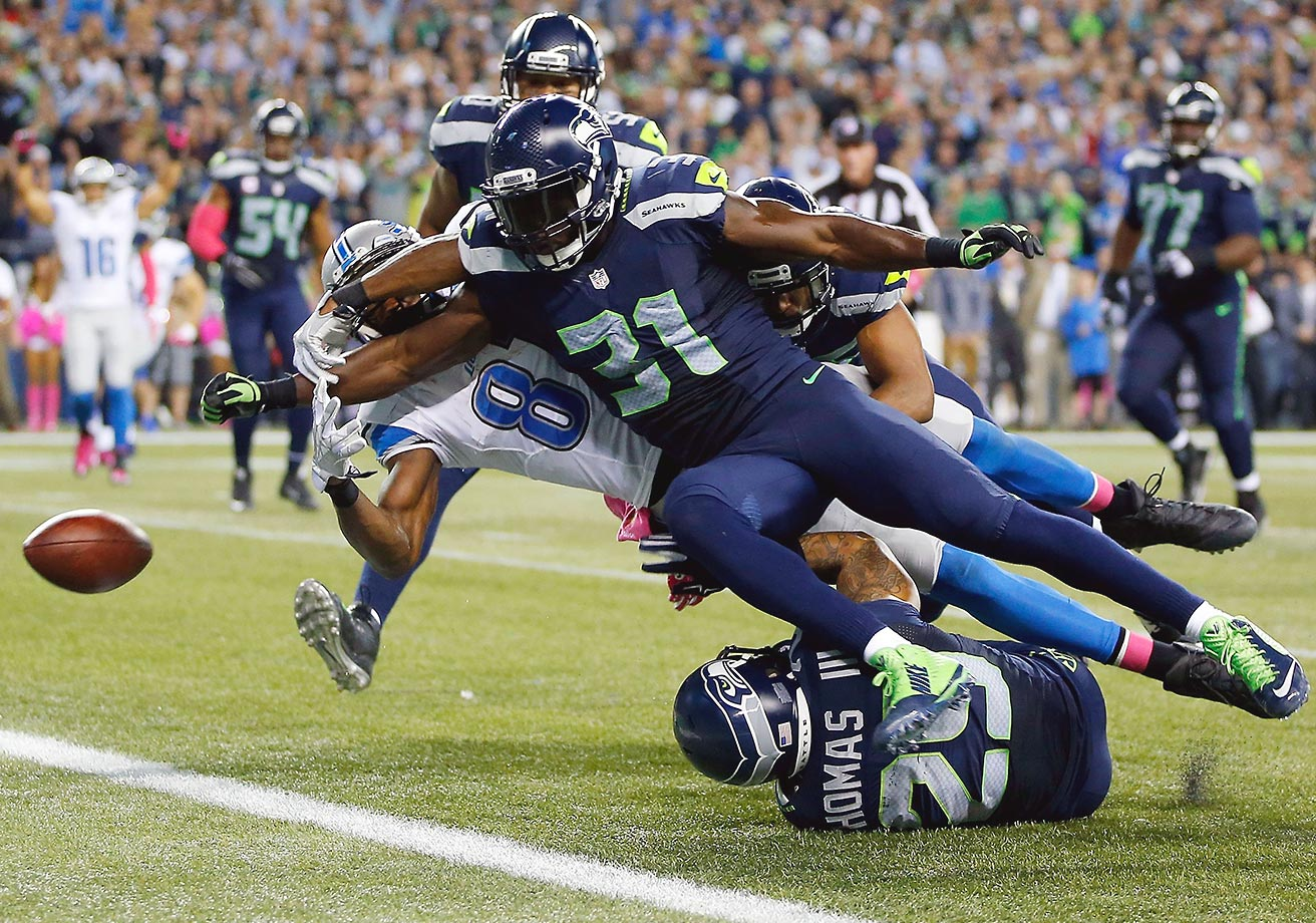 Kam Chancellor of the Seattle Seahawks forces Calvin Johnson to fumble the ball at the goal line during the fourth quarter of their game in Seattle.
