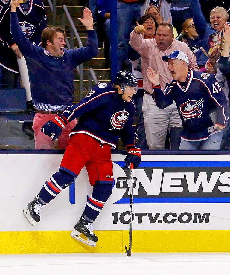 Cam Atkinson of the Columbus Blue Jackets celebrates after beating Henrik Lundqvist for a goal.