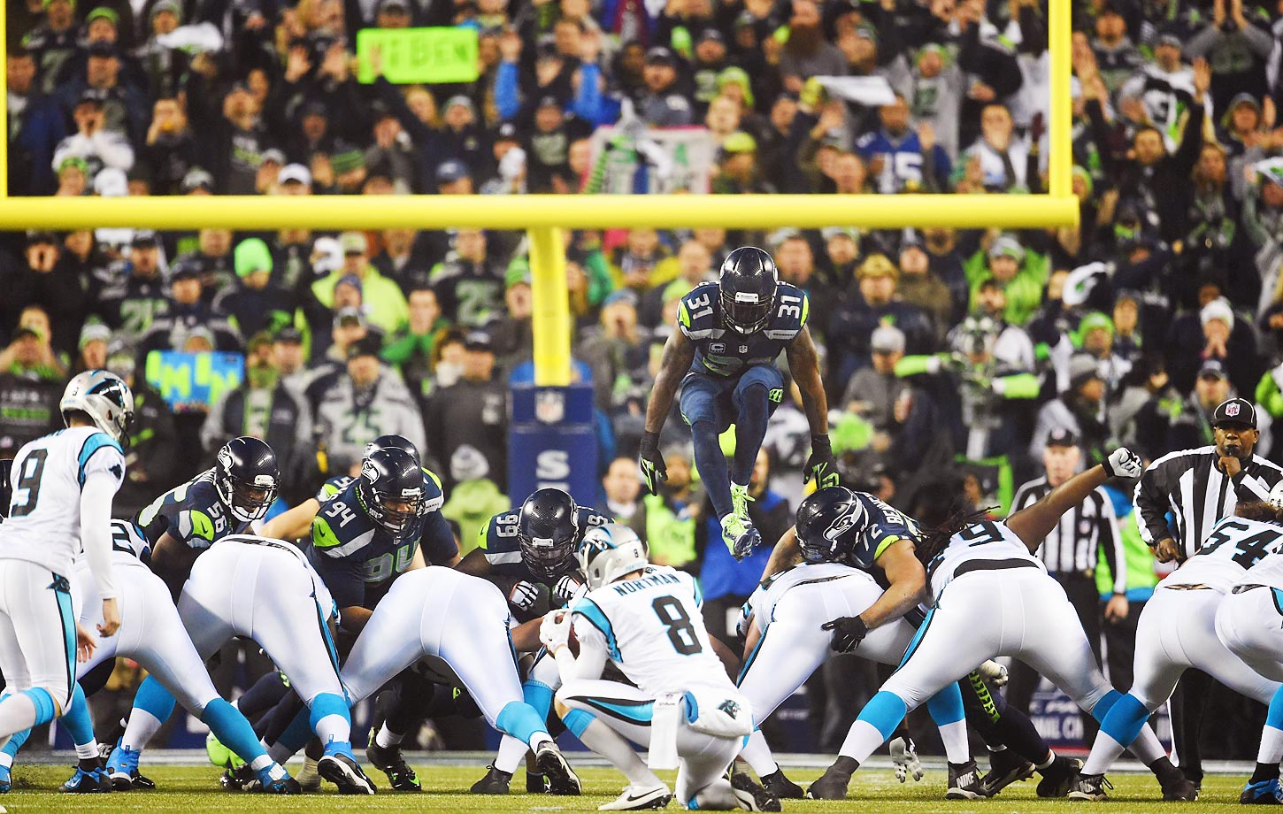 Kam Chancellor jumps over the line to attempt to block a field goal kick during an NFC Divisional Playoff game.