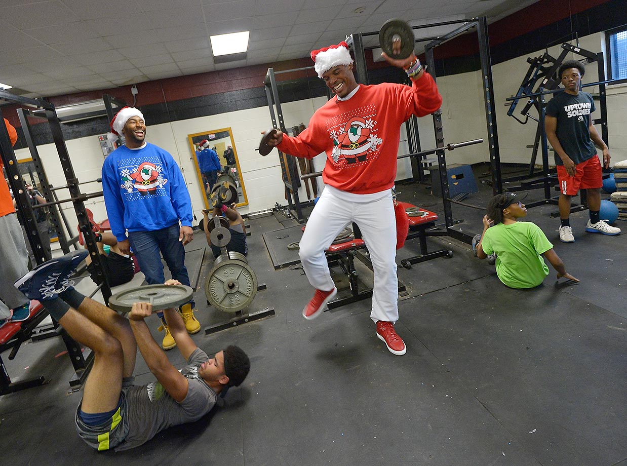 Cam Newton of the Carolina Panthers joins Ride Along 2 stars Kevin Hart and Ice Cube in surprising students at Harding High with athletic gear and a $7,500 check for a new weight room as part of Newton's annual Santa Cam's Surprise Sleigh.