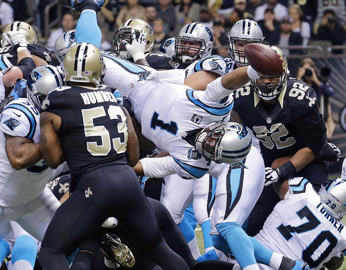 Cam Newton dives over the pile for a touchdown in the first half of Carolina's game against the Saints.