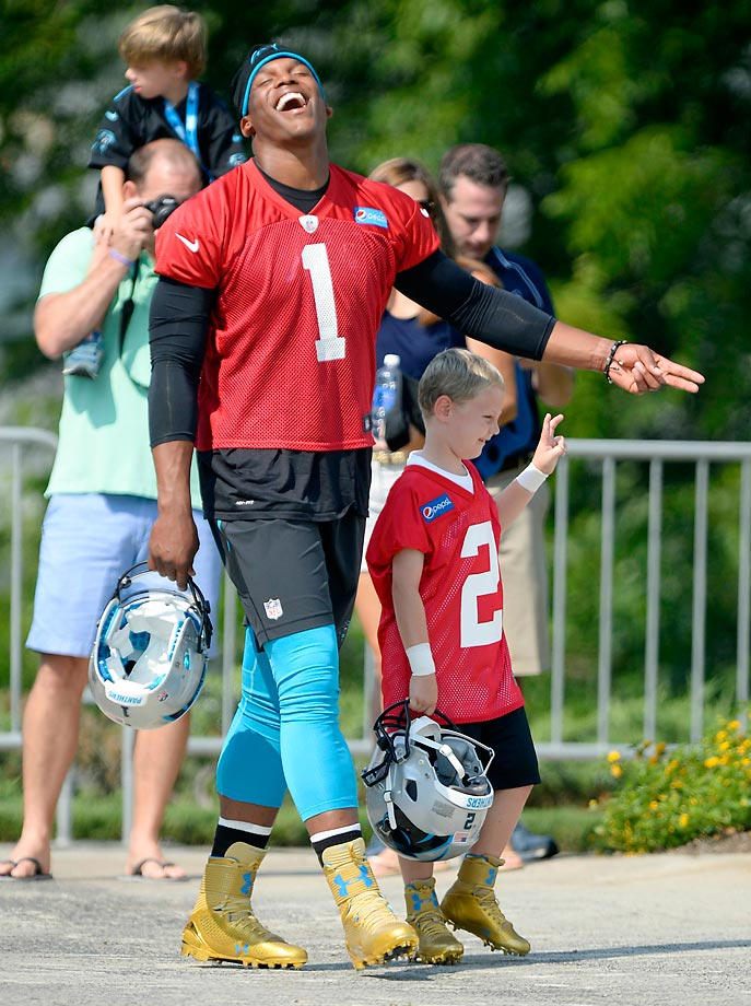 Carolina Panthers quarterback Cam Newton laughs with George Gring, a 6-year-old diagnosed with Burkitt's Lymphoma. The Panthers and the Make-A-Wish Foundation granted George's wish to be a Carolina Panther and to play with Cam Newton.