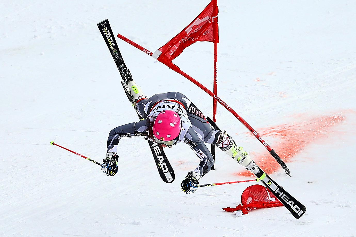 Candace Crawford of Canada crashes in her heat against Viktoria Rebensburg of Germany during the Nations Team Event at Golden Peak Stadium on Day 9 of the 2015 FIS Alpine World Ski Championships.