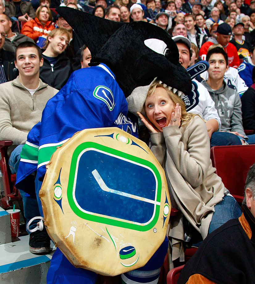 Fin, the mascot of the Vancouver Canucks, takes a bite of actress Anne Heche during a game at General Motors Place in Vancouver.