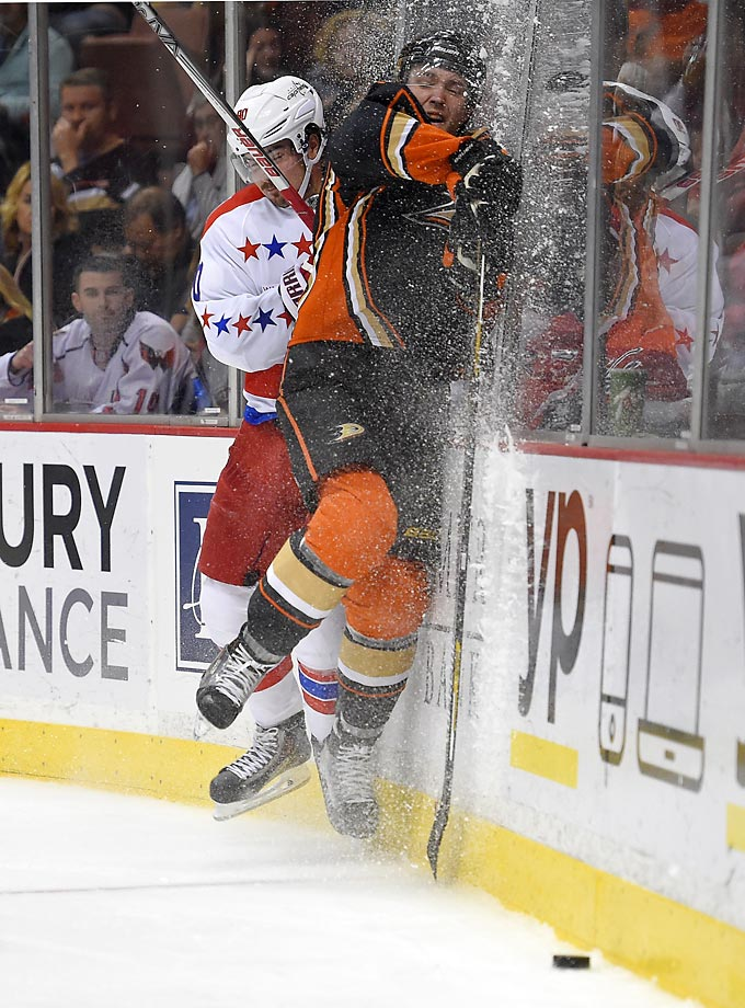 Marcus Johansson of the Washington Capitals flattens Cam Fowler of the Anaheim Ducks during the Capitals' 5-3 victory.