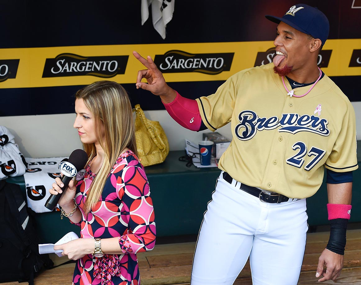 Carlos Gomez of the Milwaukee Brewers photobombs Fox Sports reporter Sophia Minnaert.