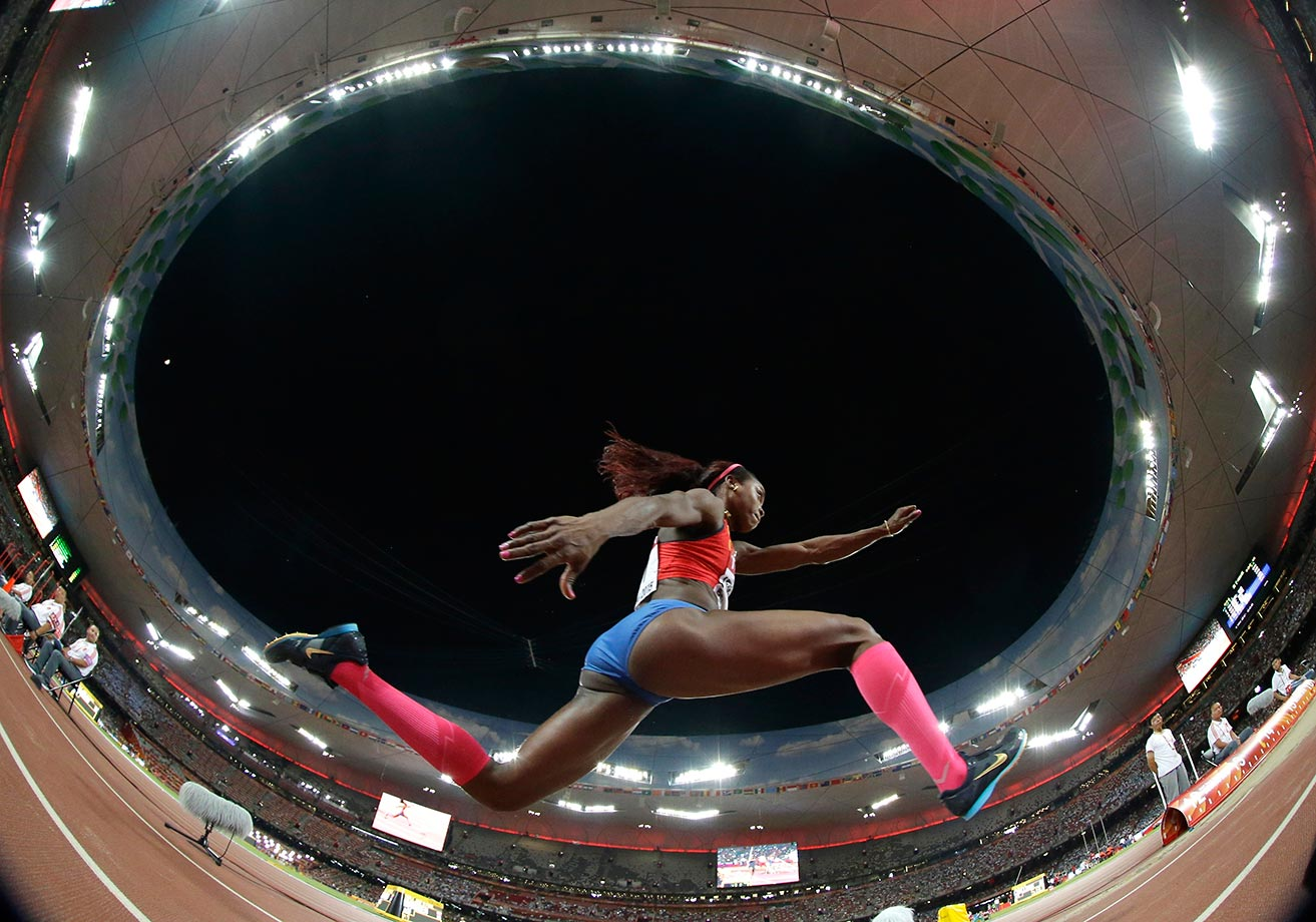 Caterine Ibarguen competes in the triple jump final at the World Athletics Championships in Beijing.