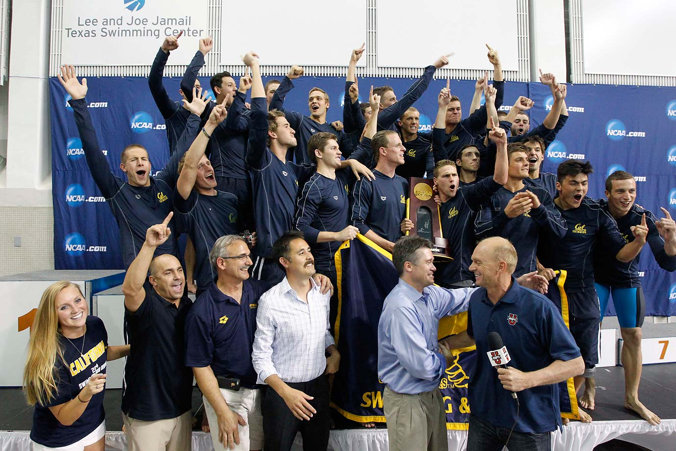 California's men's swimming and diving team poses for celebratory pictures after winning the sport's national title.