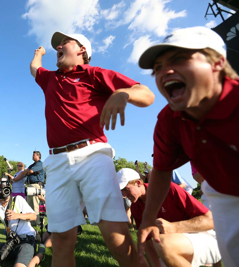 Two members of Alabama's contingent scream in delight during the school's victory in the Men's Golf National Championship.