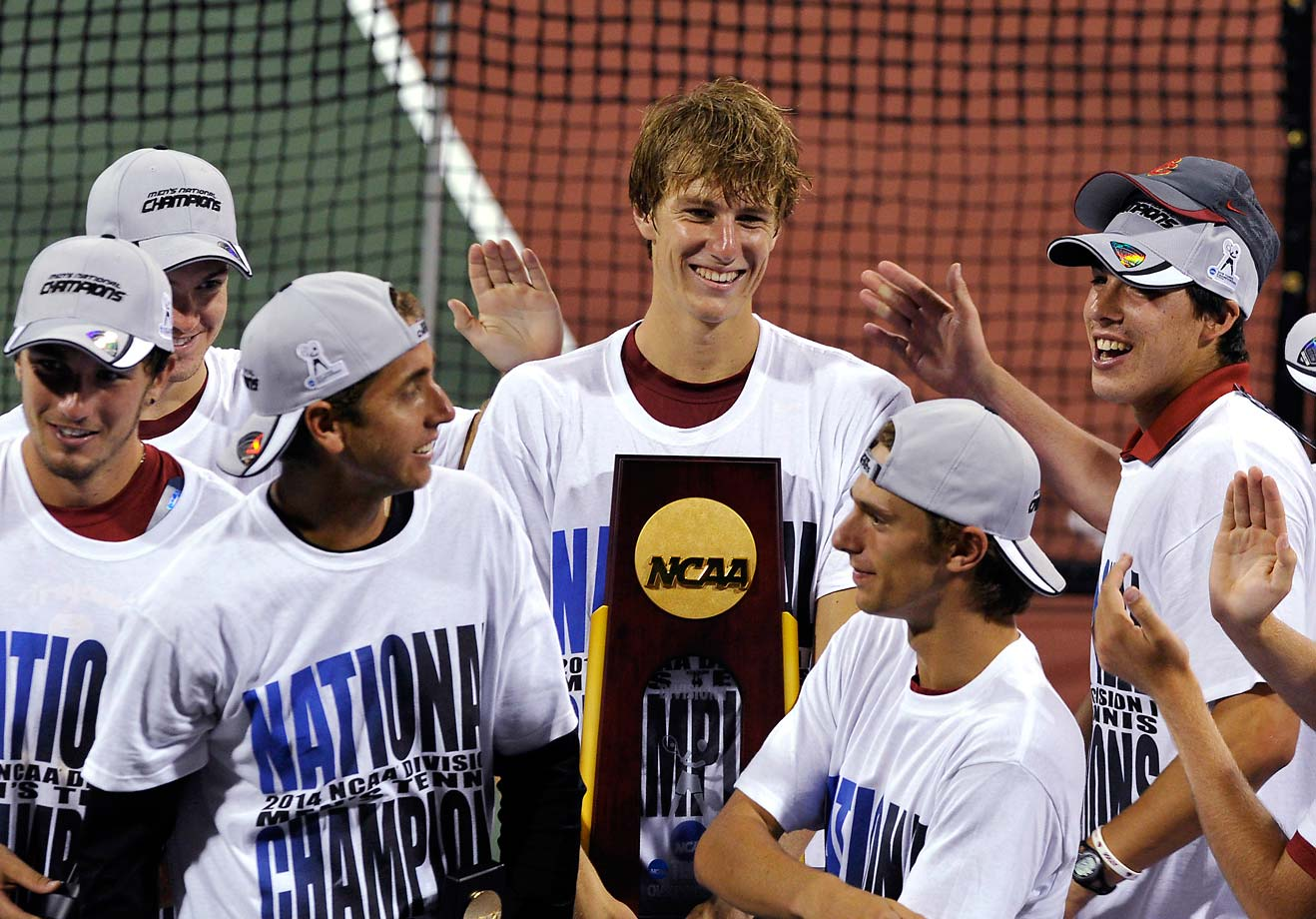 USC's men's tennis team celebrates its National Championship win.  They made it into the history books, since their victory makes it the school's fifth in six years.