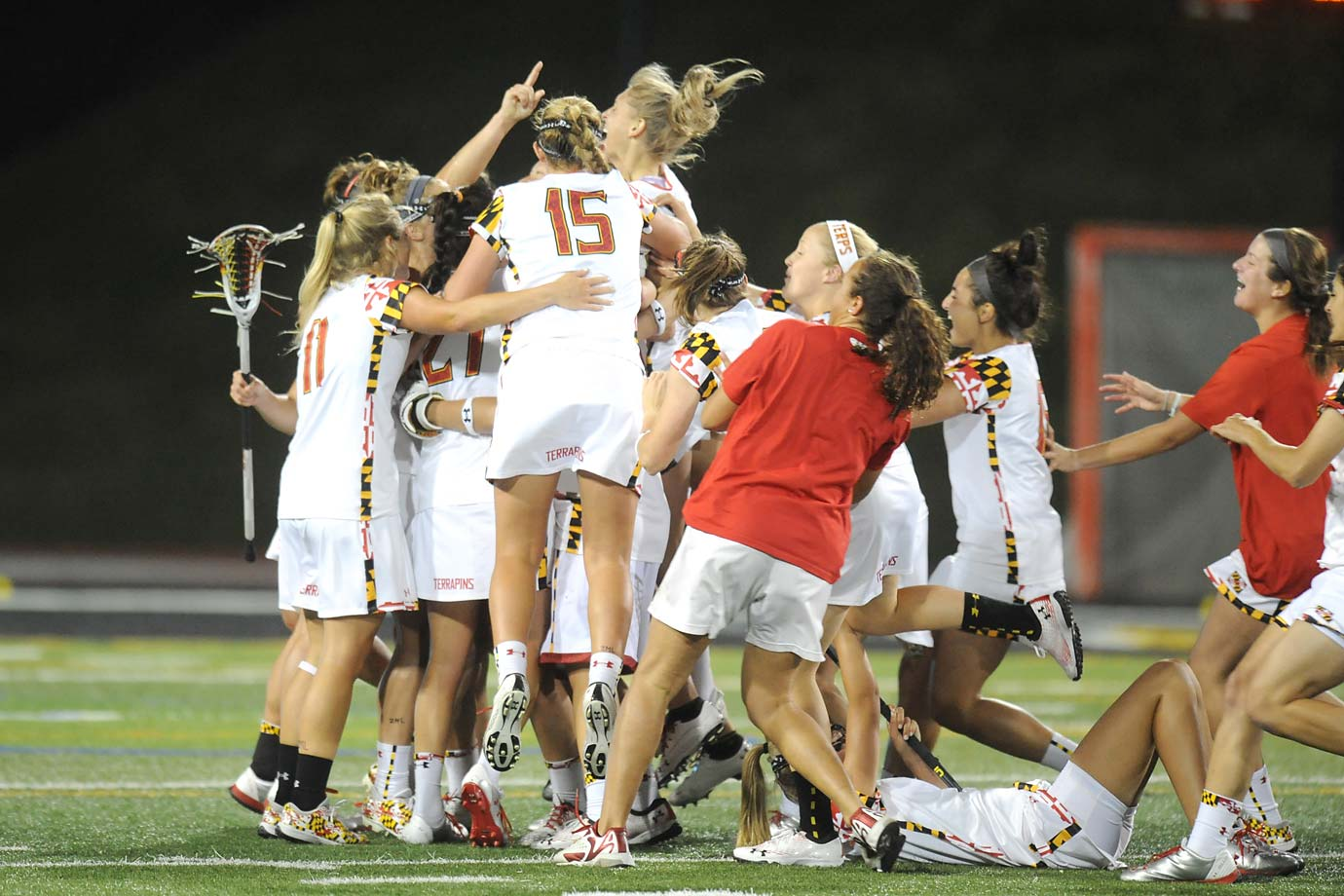 The Maryland Terrapins celebrate after defeating the Syracuse Orange 15-12 to win the Women's Lacrosse Championship for the 11th time.  The triumph was special considering they lost in last year's final by one goal.