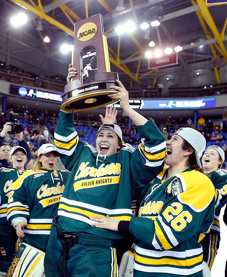 The Clarkson Golden Knights celebrate after beating two-time defending champions Minnesota 5-4 to win their first national championship.  With the victory, Clarkson became the first school besides Wisconsin, Minnesota Duluth and Minnesota to win the women's hockey title.