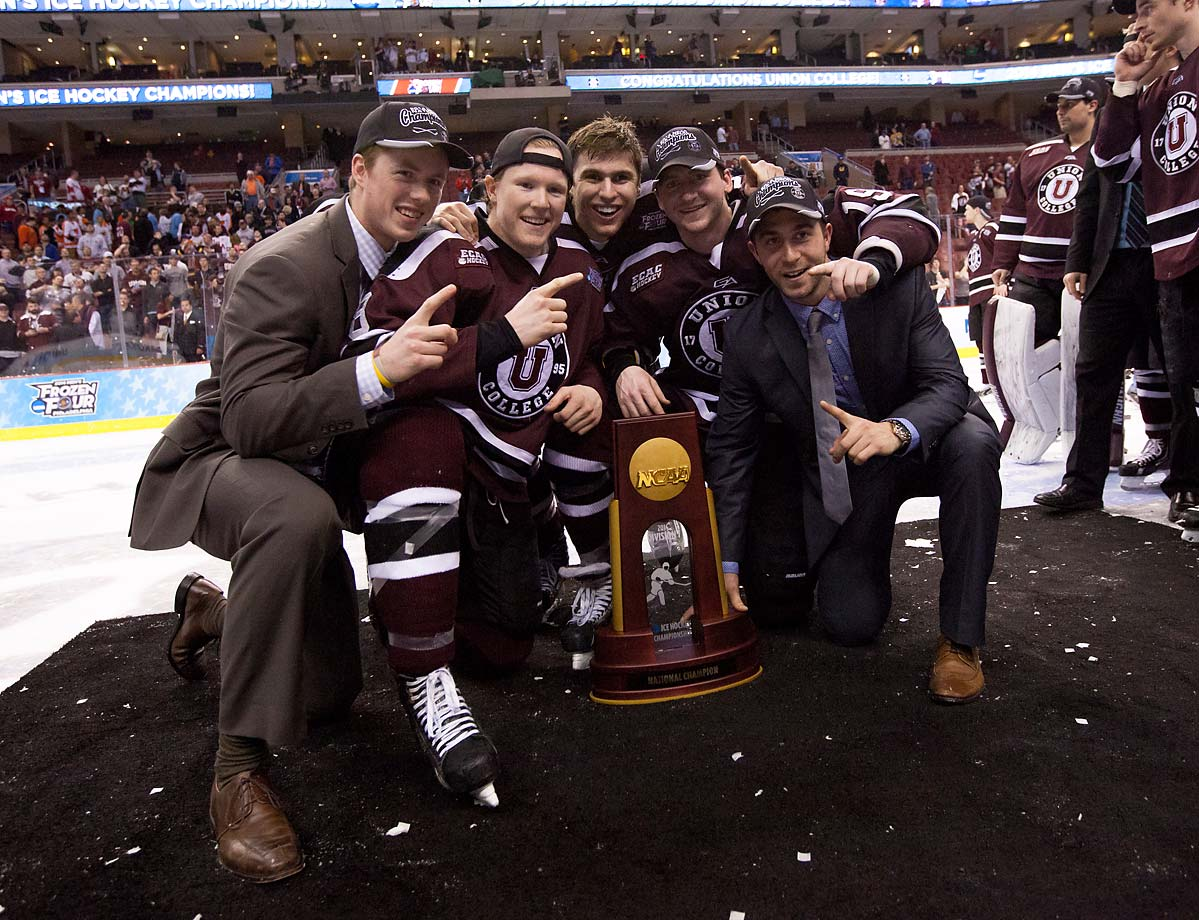 "Members of the Union (N.Y.) men's hockey team celebrate after winning the Men's Hockey National Championship.  In a classic ""David versus Goliath"" tale, Union College (enrollment: 2,200) defeated Minnesota (enrollment: 48,000) 7-4 to capture its first-ever title."
