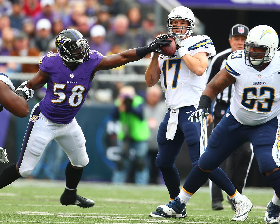 Ravens linebacker Elvis Dumervil gets a hand on the ball as Chargers quarterback Philip Rivers prepares to throw. Rivers had one interception, which came after Dumervil hit his arm during a pass.