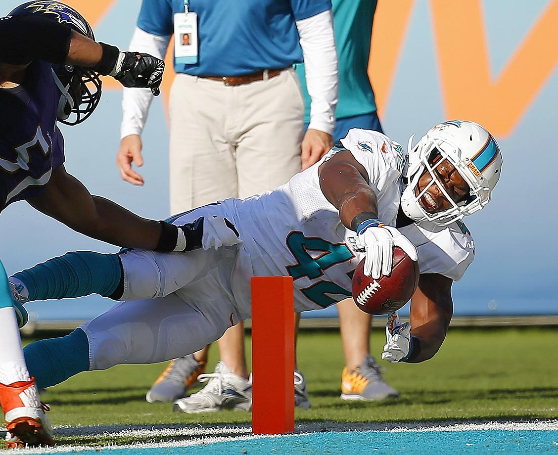 Charles Clay reaches unsuccessfully for the end zone in the game against the Ravens.  The Dolphins settled for a field goal on the drive.