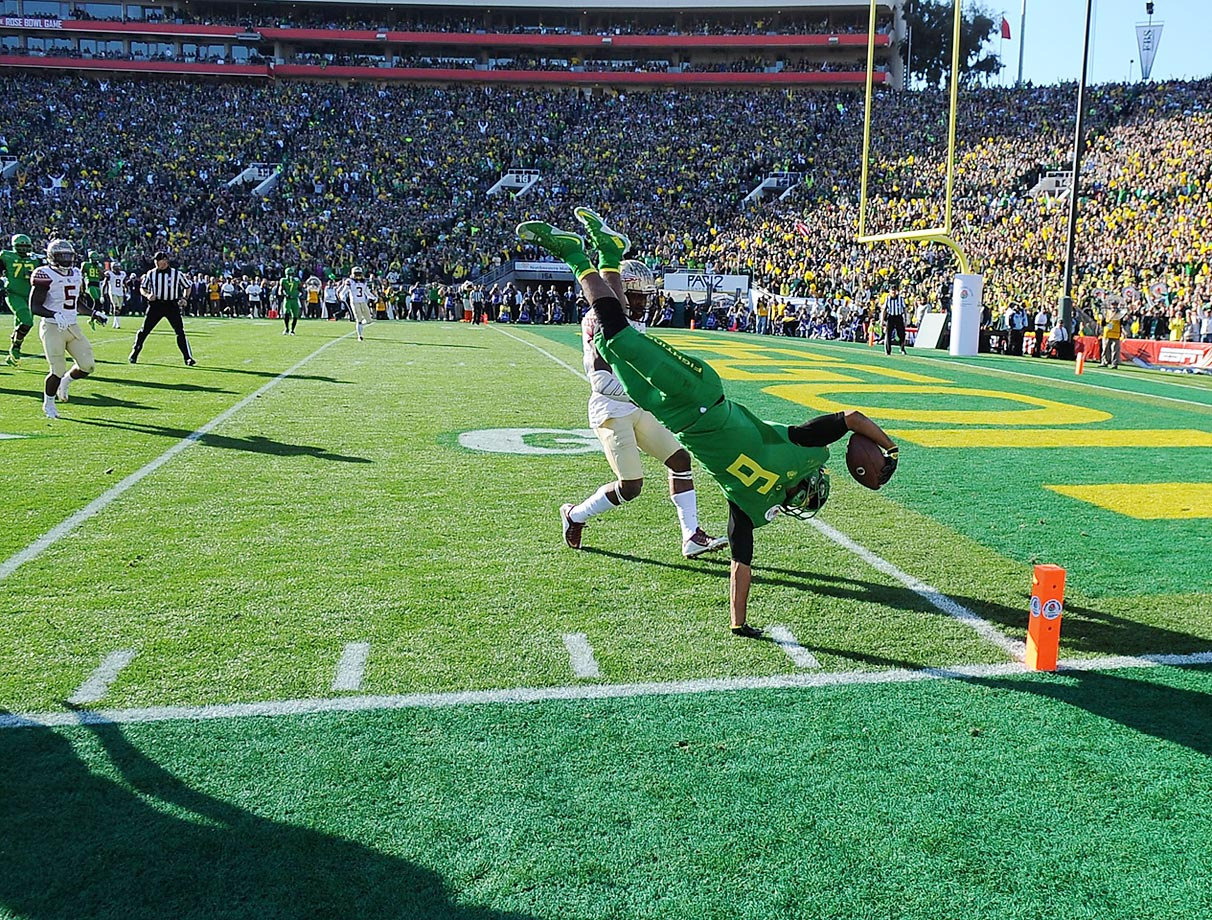 Charles Nelson of the Oregon Ducks leaps to the half yard-line during a college football playoff semifinal game at the Rose Bowl.