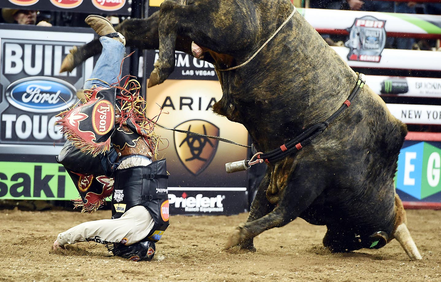 "Chase Outlaw takes a fall off ""Lite Em Up"" during the Professional Bull Riders Monster Energy Buck off at Madison Square Garden. The World's top 35 bull riders were in NYC for the event."
