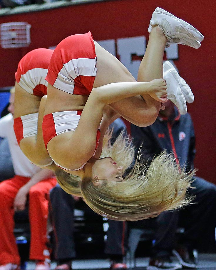 Utah  cheerleaders flip during their team's  game against Southern California.
