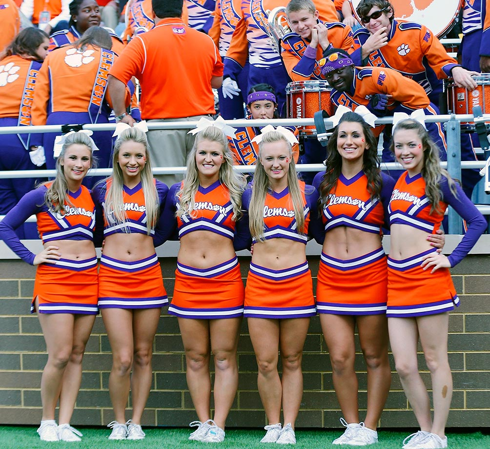Clemson cheerleaders photobombed by the band.
