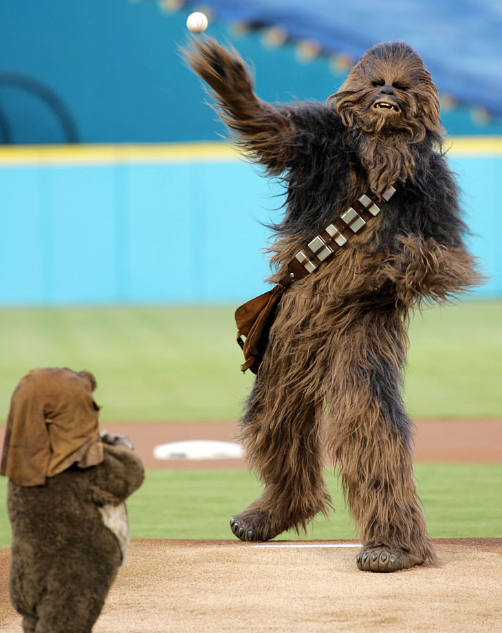 Chewbacca throws out the ceremonial first pitch as Wicket the Ewok looks on before a game between the Florida Marlins and Washington Nationals on Aug. 22, 2006 at Sun Life Stadium in Miami.