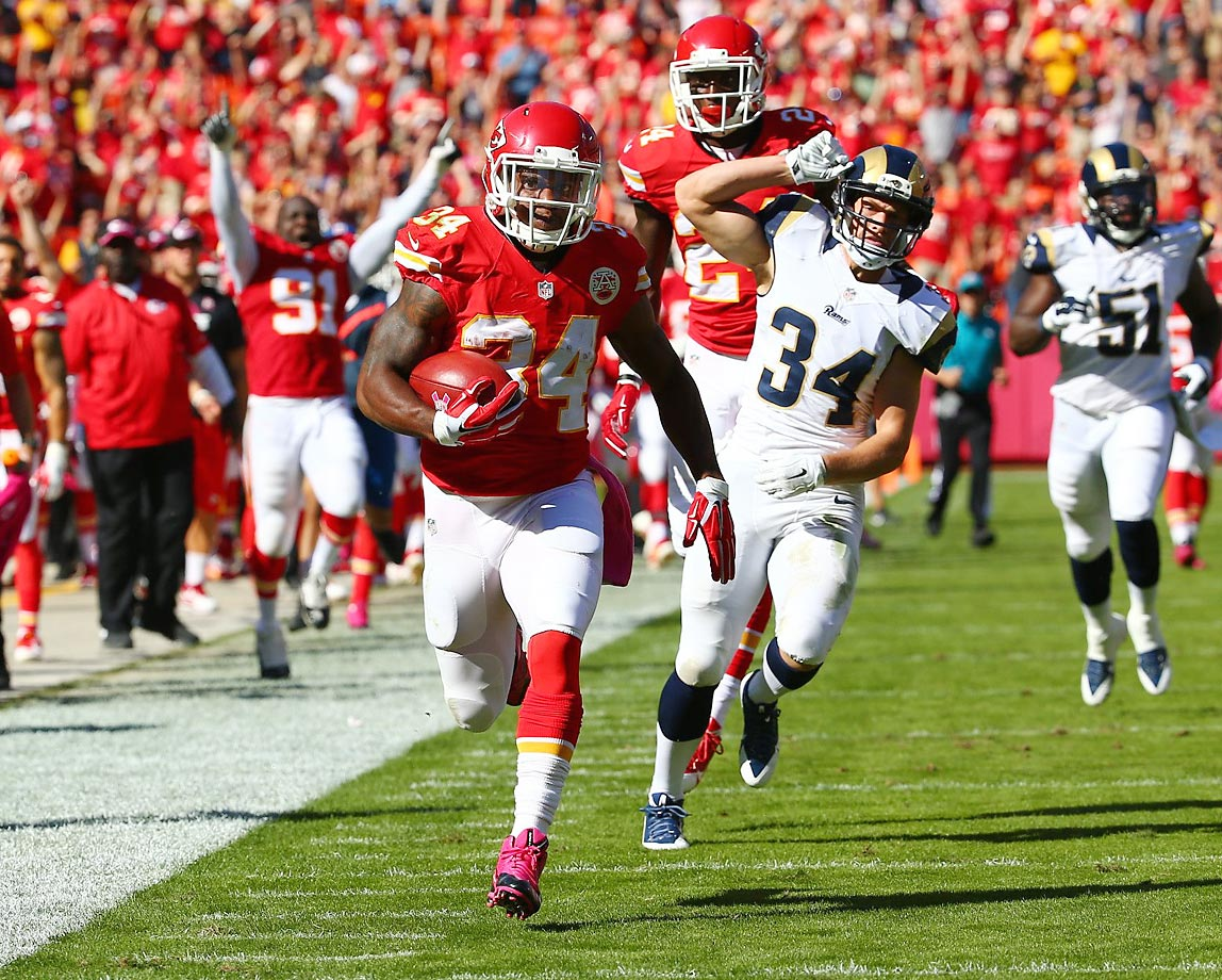 Knile Davis scores on a 98-yard kickoff return against the St. Louis Rams on Sunday.