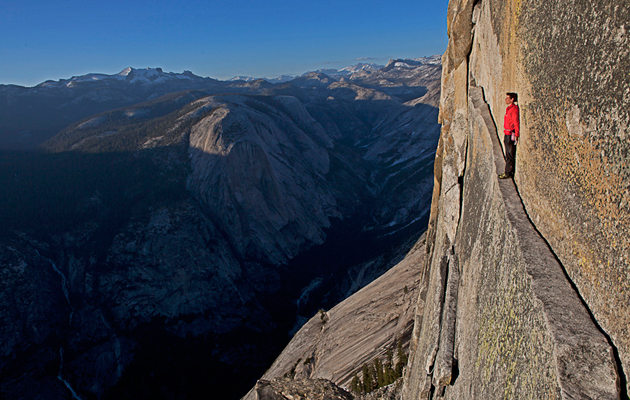 Jimmy Chin captures Alex Honnold reenacting his rope-less free climb of the 2,500-foot northwestern face of Halfdome, arguably the hardest free solo climb to date in Yosemite National Park.