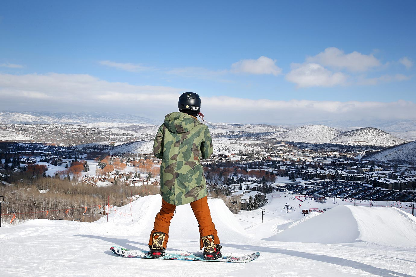 Snowboarder Chloe Kim surveys the mountain and the half pipe at Park City.