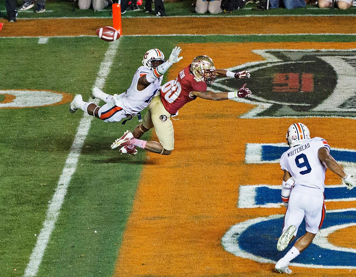Chris Davis of Auburn tries to tackle Rashad Greene of Florida State in the BCS Championship game.