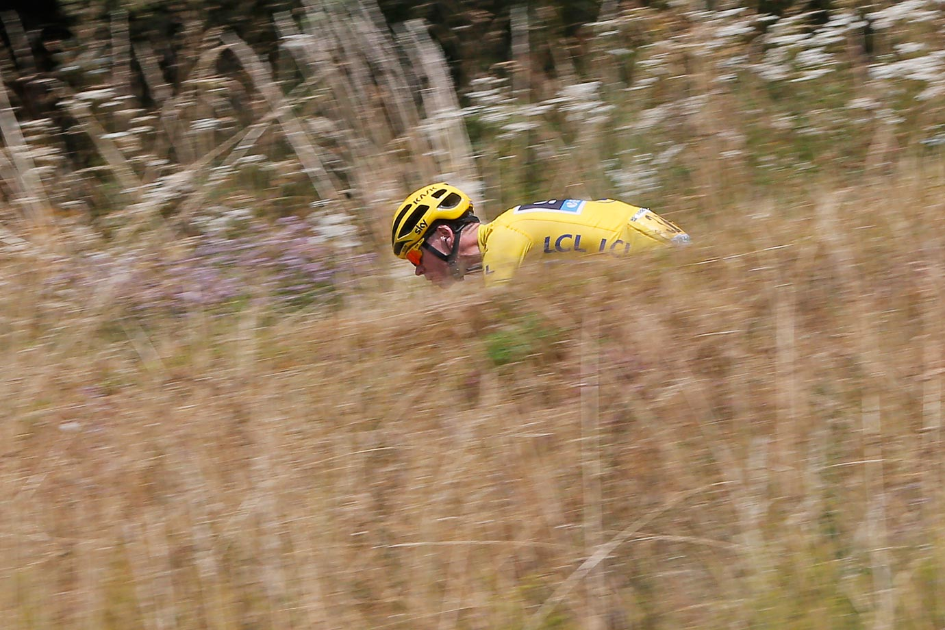 Chris Froome speeds downhill during the 12th stage of the Tour de France.