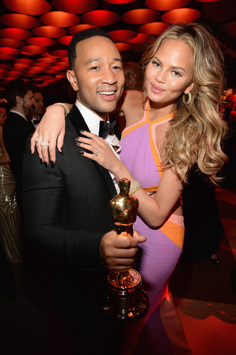 Chrissy Teigen and husband John Legend attend the 2015 Vanity Fair Oscar Party