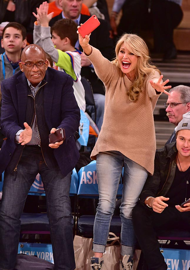 Al Roker and Christie Brinkley are excited about something at this game between the Golden State Warriors and the New York Knicks.