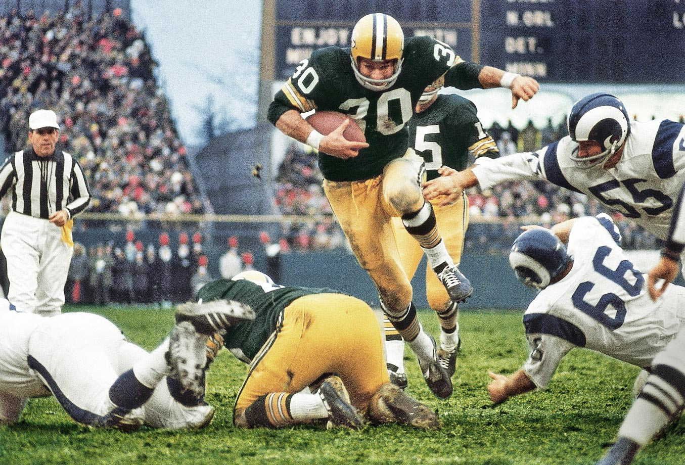 Green Bay Packers running back Chuck Mercein carries the ball against the Los Angeles Rams in December 1967.