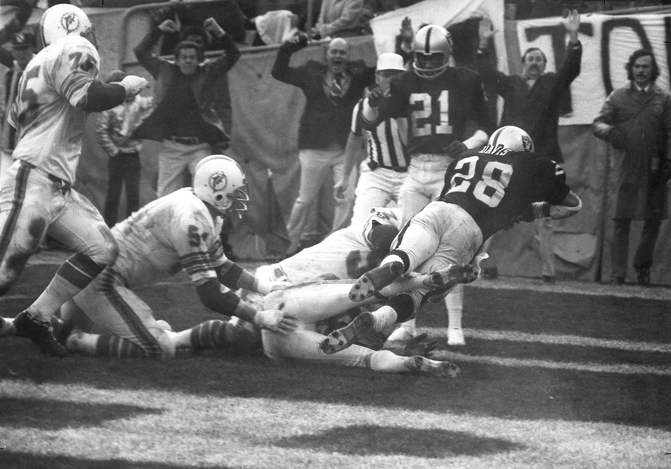 "1974: Clarence Davis ""Sea of Hands"" catch gives Oakland a last-second playoff win over two-time champion Miami."