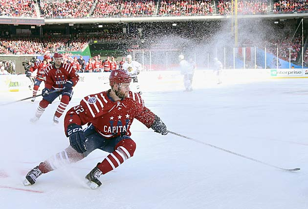 Mike Green of the Capitals sends a shower of chips into the air. Ice quality has been good.